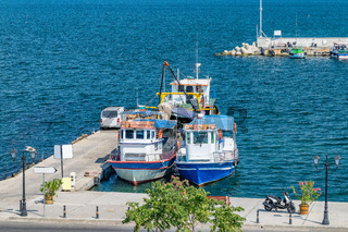 Fishing Boats docked at a harbor port in Nessebar ancient city, one of the major seaside resorts on the Bulgarian Black Sea Coast. Nesebar or Nesebr is a UNESCO World Heritage Site. Boats in Nessebar