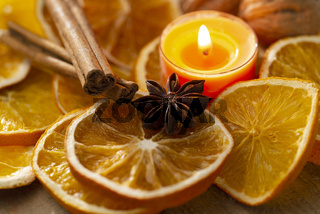 Natural Christmas decoration - orange slices, spices and candle