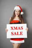 miss santa presenting xmas sale sign
