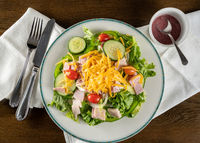 Flat lay of chef salad take out food arranged on plate