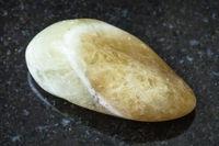 tumbled Prasiolite (green quartz) stone on black
