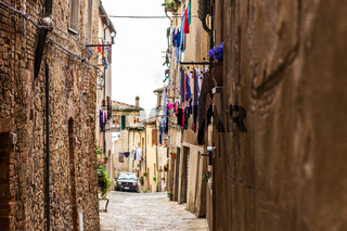 Street of the medieval village Volterra. Italy