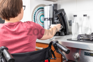 disabled woman getting coffee in the kitchen