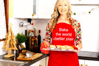 A woman with baked pastry pies in the kitchen at Christmas time