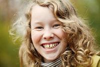Outdoor portrait of happy blond girl