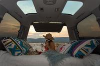 Woman on road trip with her van has a rest break