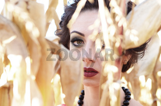 Young caucasian brunette woman portrait at cornfield