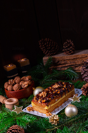 Chocolate gingerbread with filling, jam and nuts