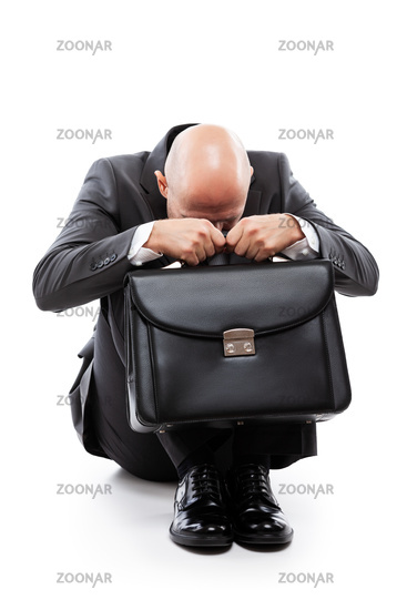 Crying tired or stressed businessman in depression hand holding briefcase