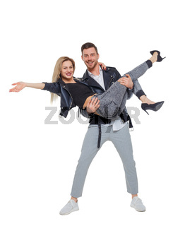 A man is holding a woman in his arms.