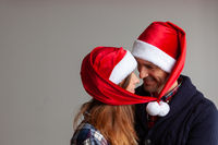 Happy couple in Santa hats