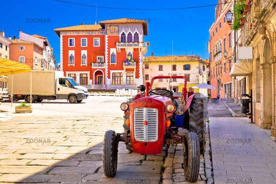 Town of Vodnjan colorful square and old tractor view