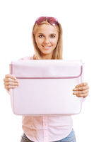 Beautiful young blonde woman smiling and showing pink briefcase