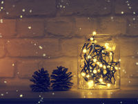 Christmas lights in a jar on a table