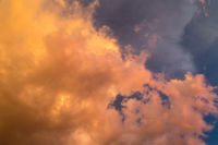 Dramatic clouds at colourful moody sunset