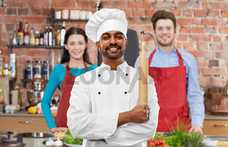 male indian chef with rolling-pin at cooking class