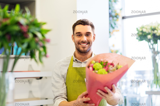 smiling florist man with bunch at flower shop