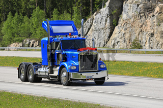 Blue Kenworth W900 Trucking in Summer