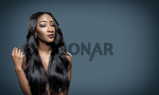Black beautiful woman with long luxurious shiny hair