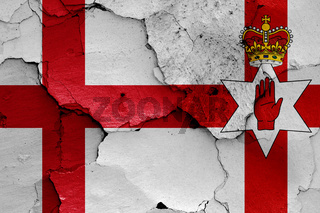 flags of England and Northern Ireland  painted on cracked wall