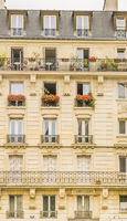 flower-decked facade of exemplary parisian townhouse