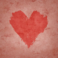 Red watercolor painted heart shape on pink