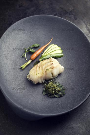 Fried Danish skrei cod fish filet with vegetable