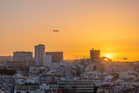 Sunset Over Lisbon City with Air Plane in Sky