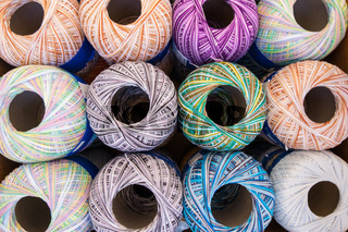 Colorful spools of thread reels.