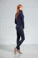 Alluring redhead woman posing in studio