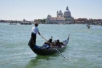 Tourist, gondolier, gondola, Santa Maria della Salute, church, Venice, Italy, Europe