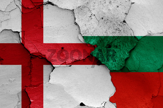 flags of England and Bulgaria painted on cracked wall