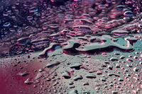 Abstract close-up water background with neon lights.