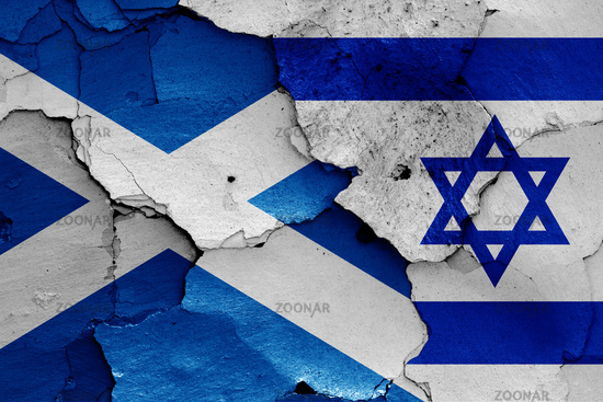 flags of Scotland and Israel painted on cracked wall