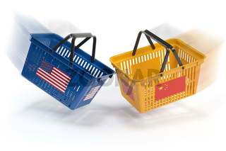USA China  market conflict.  Economic trade war concept.Two opposing shopping baskets with USA and China flags.,