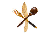 Wooden knife, fork and spoon on white background