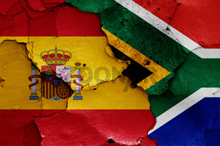 flags of Spain and South Africa painted on cracked wall