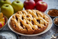 Fresh baked tasty homemade apple pie cake with ingredients on side