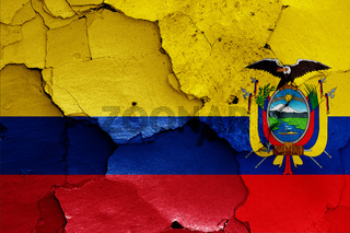 flags of Colombia and Ecuador painted on cracked wall