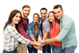 group of smiling friends stacking hands