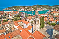 Town of Vela Luka on Korcula island church tower and coastline aerial view