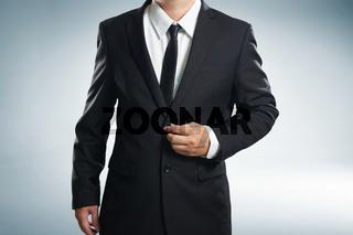 Confidence businessman in black suit