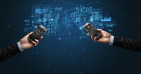 Two hands holding smartphones to sync business data