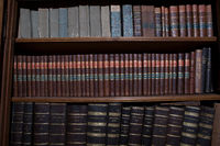 Old books in wooden row library
