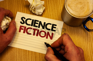 Handwriting text writing Science Fiction. Concept meaning Fantasy Entertainment Genre Futuristic Fantastic Adventures Man holding pen ideas notebook crumpled papers coffee cup wooden background.