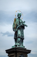 PRAGUE, CZECH REPUBLIC - MAY 21, 2009: Statue on the historic Charles Bridge in Prague