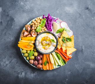 Hummus platter with assorted snacks