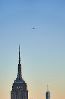 Helicopter over Empire State Building and One World Trade Center