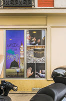 photographs of muslim pilgrims at the kaaba, shop window display