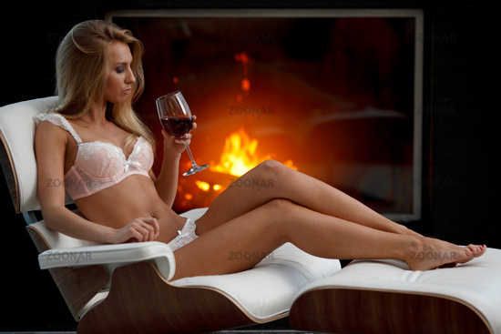 Girl in lingerie with wine
